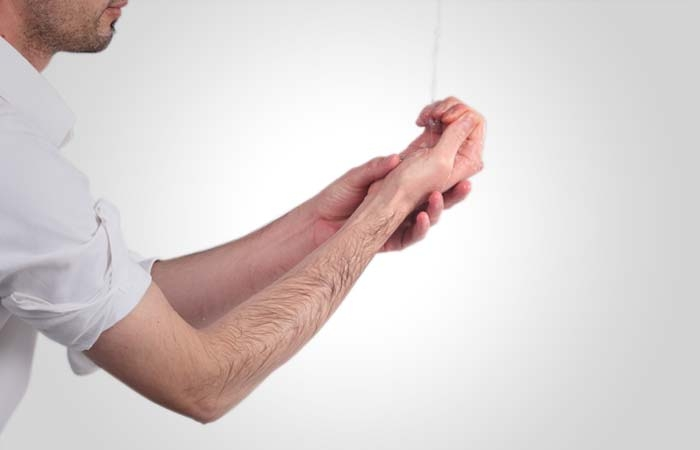 He washes the right hand up the far end of the elbow, and then he does the same thing with the left hand and forearm. It is obligatory to wash the hands up to the elbows once, but it is recommended to do so three times.